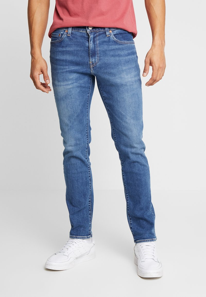 Levi's® - 511™ SLIM - Trousers - blue denim