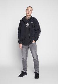 Levi's® - 502™ TAPER - Jeans slim fit - adjustable black - 1