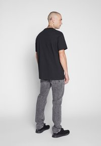 Levi's® - 502™ TAPER - Jeans slim fit - adjustable black - 2