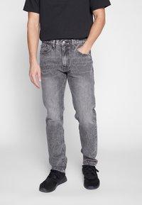 Levi's® - 502™ TAPER - Jeans slim fit - adjustable black - 0