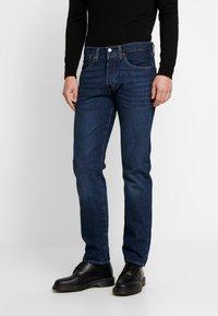 Levi's® - 501 SLIM TAPER - Zúžené džíny - med indigo - 0