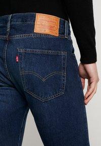 Levi's® - 501 SLIM TAPER - Zúžené džíny - med indigo - 5