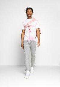 Levi's® - 511™ SLIM - Slim fit jeans - grey denim - 1
