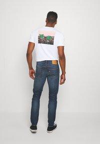 Levi's® - 512™ SLIM TAPER - Slim fit jeans - blue denim - 2