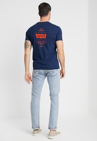 Levi's® - GRAPHIC IN NECK - Print T-shirt - dark blue - 2