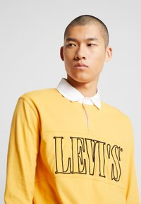 Levi's® - AUTHENTIC PIECED RUGBY - Koszulka polo - golden apricot - 4