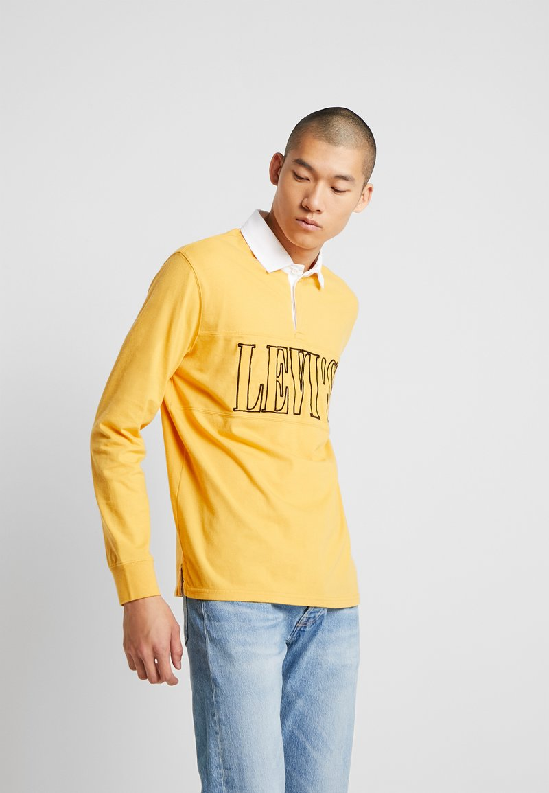 Levi's® - AUTHENTIC PIECED RUGBY - Koszulka polo - golden apricot