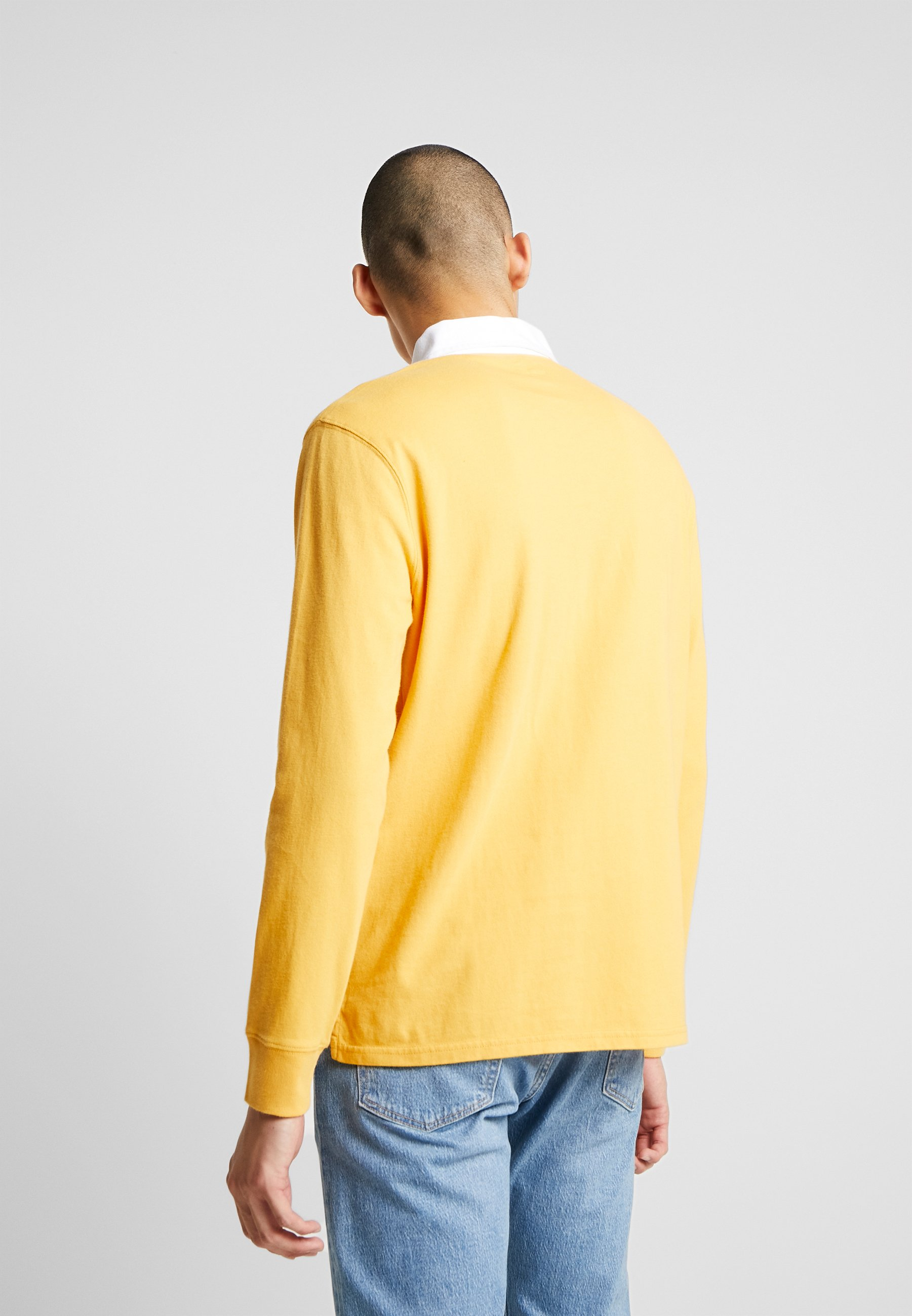 Levi's® AUTHENTIC PIECED RUGBY - Koszulka polo - golden apricot