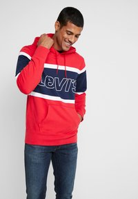Levi's® - PIECED HOODIE - Luvtröja - racer colorblock brilliant red/ white /  blues - 0