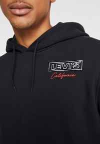 Levi's® - GRAPHIC HOODIE - Bluza z kapturem - mineral black - 5