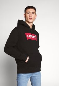 Levi's® - GRAPHIC HOODIE - Sweat à capuche - black - 0
