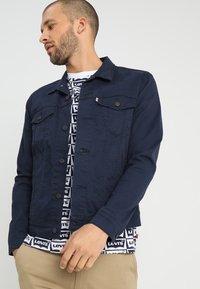 Levi's® - THE TRUCKER JACKET - Veste en jean - navy blazer - 0