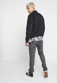 Levi's® - THE TRUCKER JACKET - Spijkerjas - liquorice trucker - 2