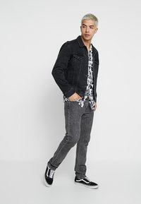 Levi's® - THE TRUCKER JACKET - Spijkerjas - liquorice trucker - 1