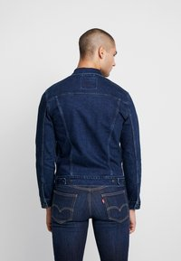 Levi's® - THE TRUCKER JACKET - Jeansjacka - dark-blue denim