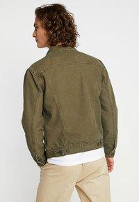 Levi's® - THE TRUCKER JACKET - Denim jacket - olive night - 2
