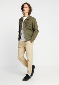 Levi's® - THE TRUCKER JACKET - Denim jacket - olive night - 1