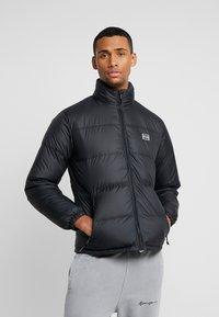 Levi's® - COIT PUFFER - Gewatteerde jas - black - 0