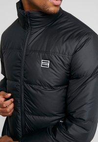 Levi's® - COIT PUFFER - Gewatteerde jas - black - 5