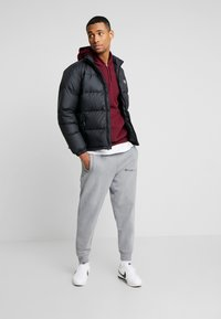 Levi's® - COIT PUFFER - Gewatteerde jas - black - 1