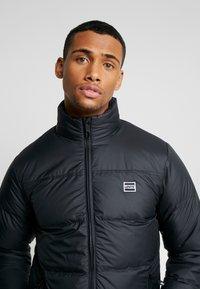 Levi's® - COIT PUFFER - Gewatteerde jas - black - 3
