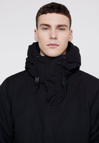 Levi's® - THERMORE PADDED - Light jacket - black - 3