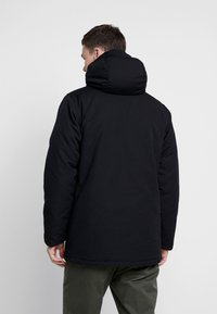 Levi's® - THERMORE PADDED - Light jacket - black - 2
