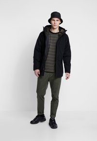Levi's® - THERMORE PADDED - Light jacket - black - 1