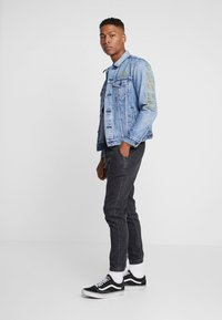 Levi's® - LEVI'S® X STAR WARS THE TRUCKER JACKET - Spijkerjas - blue denim - 1