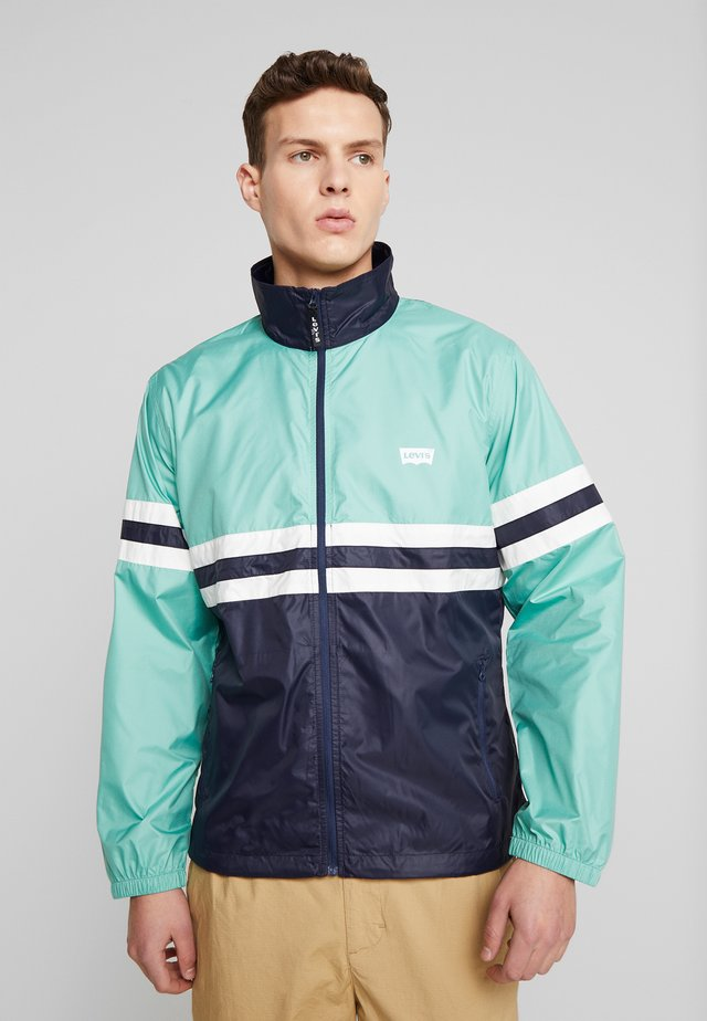 COLORBLOCKED WINDBREAKER - Chaqueta fina - night blue/crème/menthe