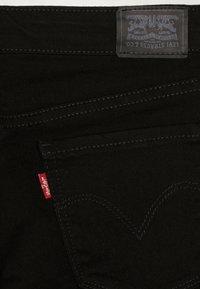 Levi's® - 710 SUPER SKINNY - Jeans Skinny - rinsed black - 4