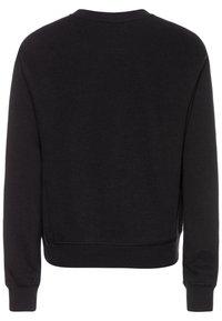 Levi's® - DROPPED SHOULDER CREW - Sweatshirts - black - 1