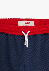 Levi's® - BASKETBALL - Tracksuit bottoms - dress blues - 3