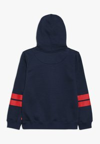 Levi's® - DIAGONAL STRIPED HOODIE - Jersey con capucha - dress blues - 1