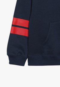Levi's® - DIAGONAL STRIPED HOODIE - Jersey con capucha - dress blues - 2