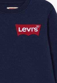 Levi's® - OVERSIZED BATWING CREWNECK - Sweatshirt - dress blues