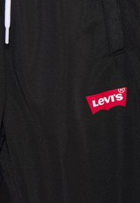 Levi's® - Tracksuit bottoms - black - 2
