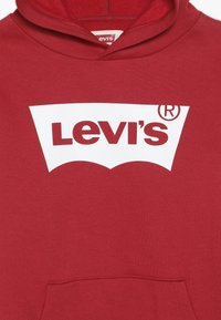 Levi's® - BATWING SCREENPRINT HOODIE - Jersey con capucha - red/white - 4