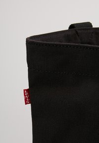 Levi's® - BATWING TOTE - Tote bag - regular black - 4
