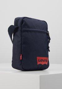 Levi's® - MINI CROSSBODY SOLID BATWING - Across body bag - navy blue - 4