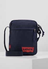 Levi's® - MINI CROSSBODY SOLID BATWING - Across body bag - navy blue - 0
