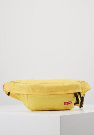STANDARD BANANA SLING BATWING - Gürteltasche - light yellow