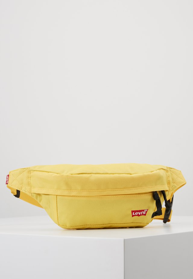 STANDARD BANANA SLING BATWING - Heuptas - light yellow