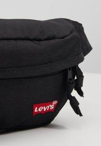 Levi's® - STANDARD BANANA SLING BATWING - Bum bag - regular black - 2
