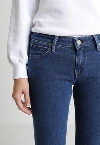 Lee - SCARLETT CROPPED - Jeans Skinny Fit - dark blue denim - 7