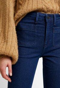 Lee - Jeans a zampa - clean say - 3