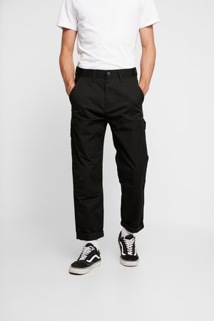 CARPENTER - Trousers - black