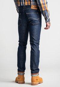 Lee - TIMBER JEAN - Slim fit jeans - clean grey - 2