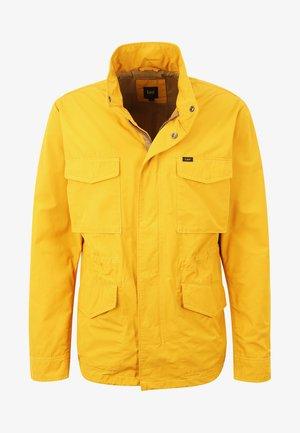 FIELD - Välikausitakki - golden yellow