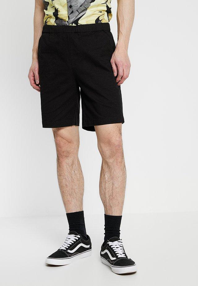 HERMOSA - Shorts - black